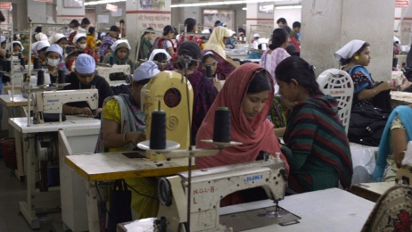 Garment workers in the factory. Still image from The True Cost